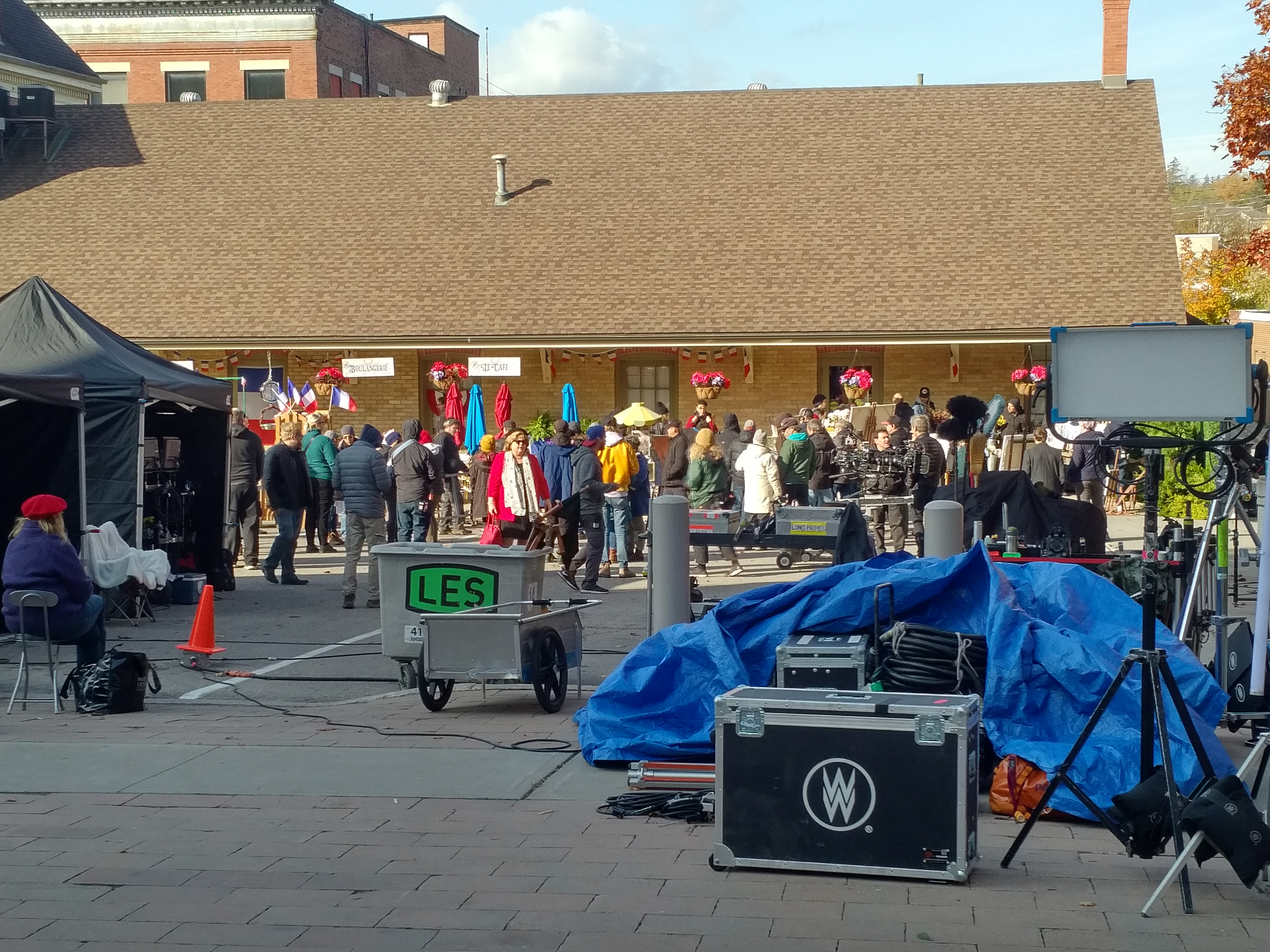 Picture of film crew in the market building parking lot